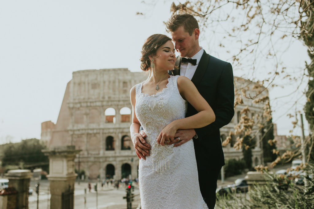 honeymoon portraits couple in front of colosseum Rome